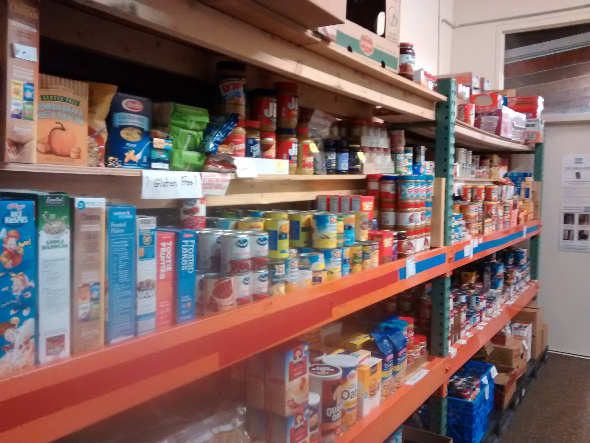 canned goods line shelf to gain food bank support.